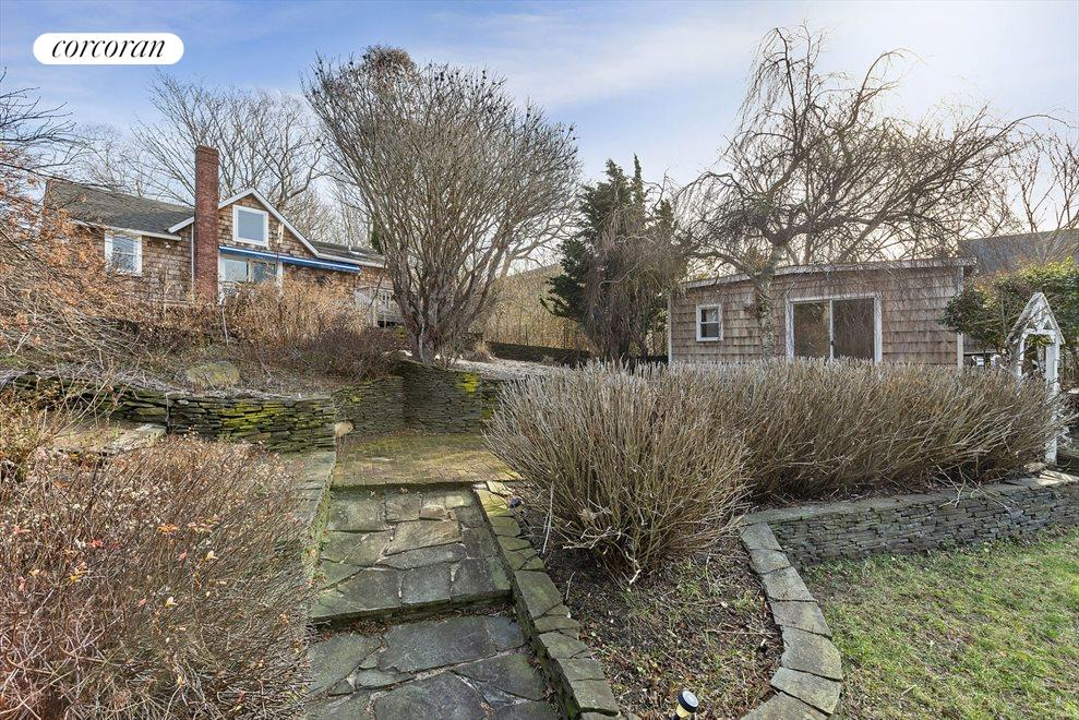 main and guest house with amazing perennial gardens and stone walkways