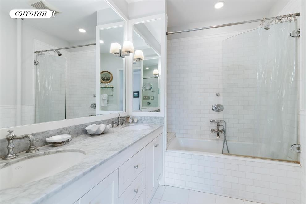 Double sinks make this marble bath luxurious.