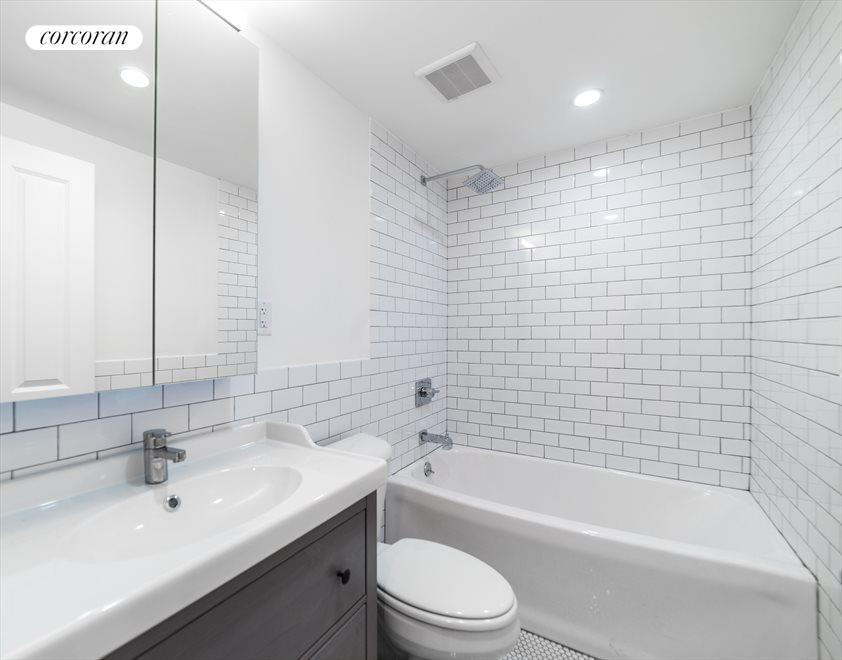 New York City Real Estate | View 1414 Saint Marks Avenue, #1 | Beautifully tiled bathroom with rainforest shower