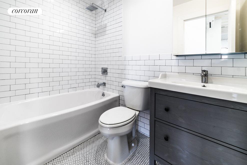 Tiled bathroom with rainforest shower