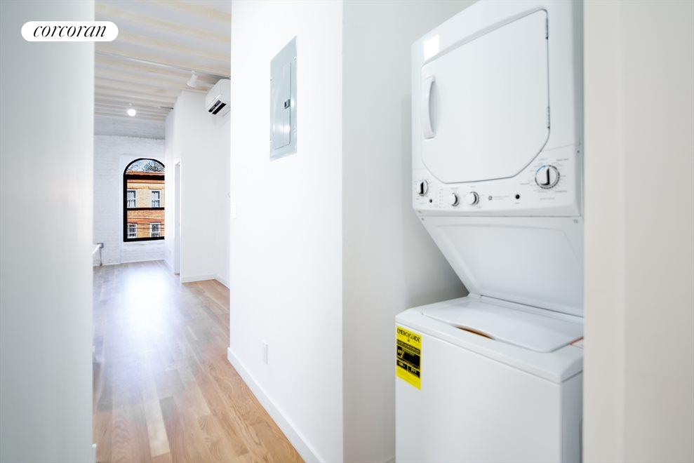 Washer and dryer in the hallway