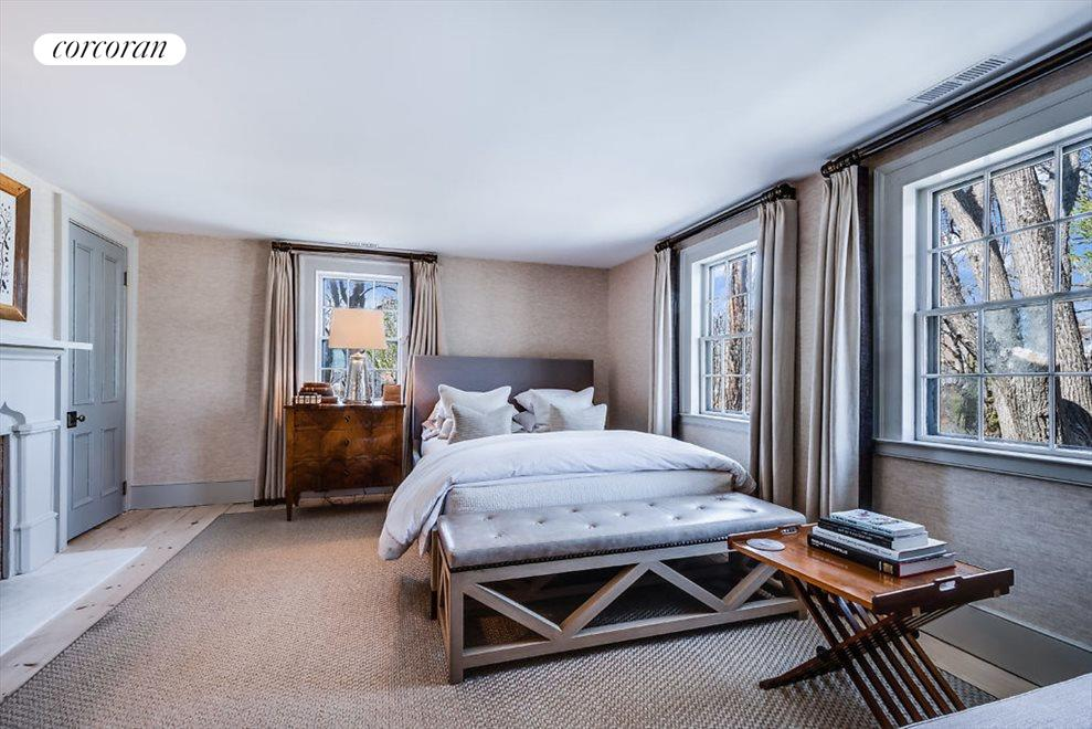 Guest bedroom with gas fireplace