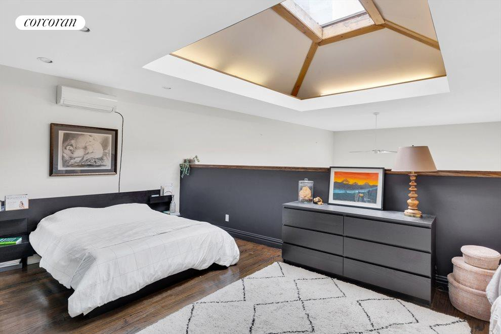 Master Bedroom and vaulted skylight