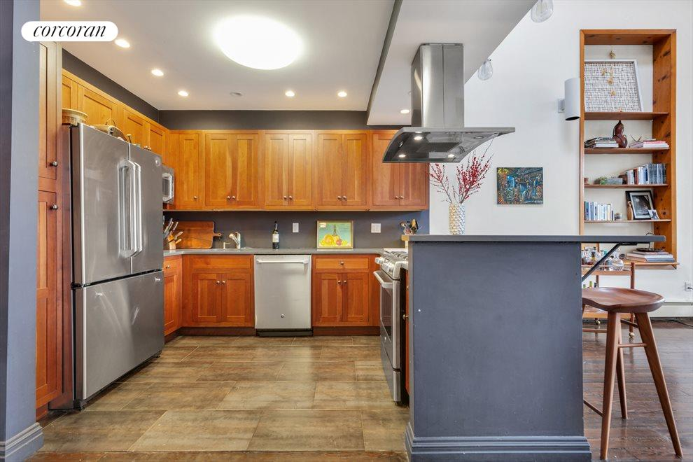 Chefs kitchen with stainless appliances