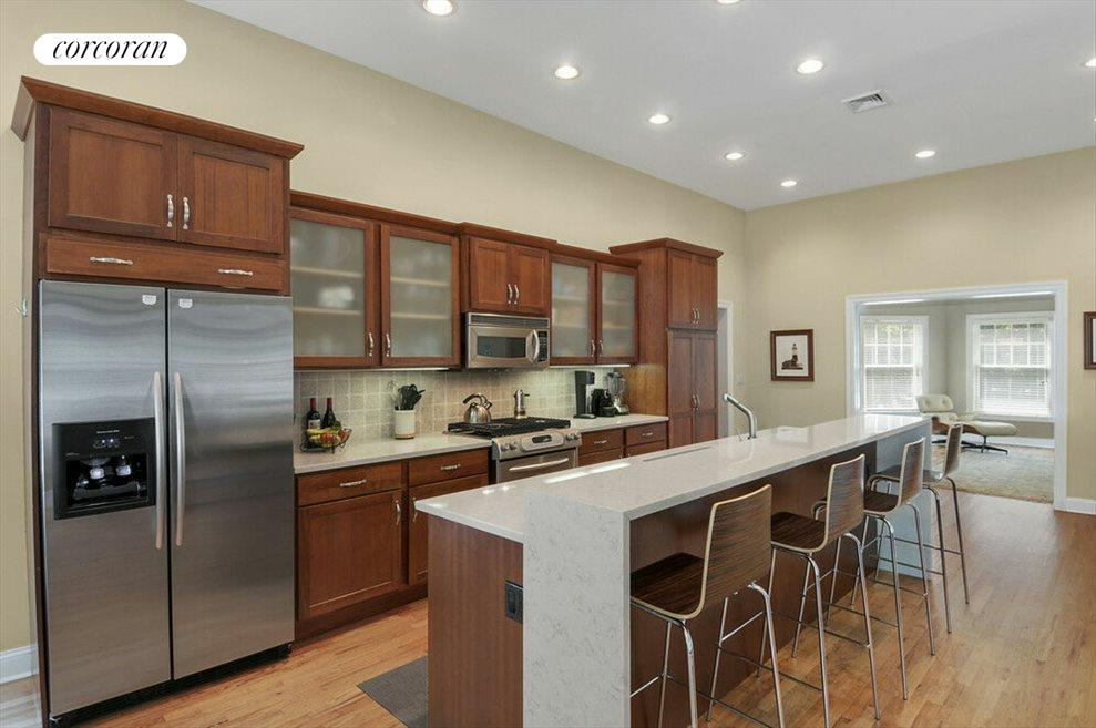 Custom kitchen with breakfast counter