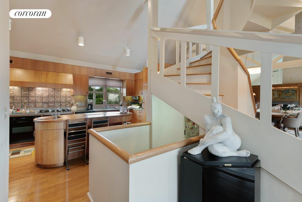 Uniquely Crafted Spiral Stairway Leading to Loft