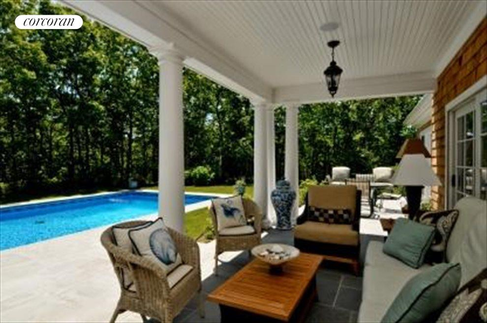 Covered patio dining overlooking pool