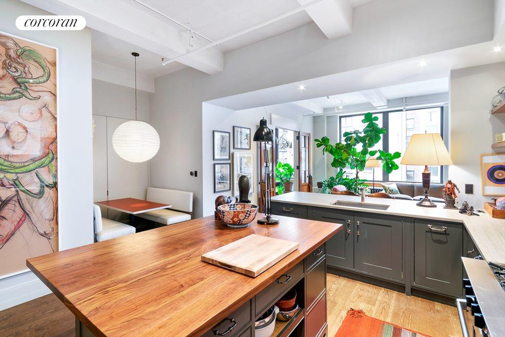 New York City Real Estate | View 142 West 26th Street, #9 FL | Kitchen with eat-in dining table