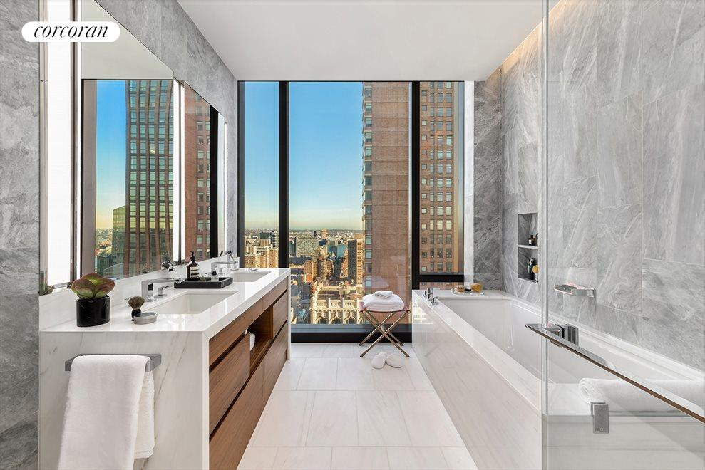 New York City Real Estate | View 277 Fifth Avenue, #33B | Ultra chic 5 fixture master bathroom.