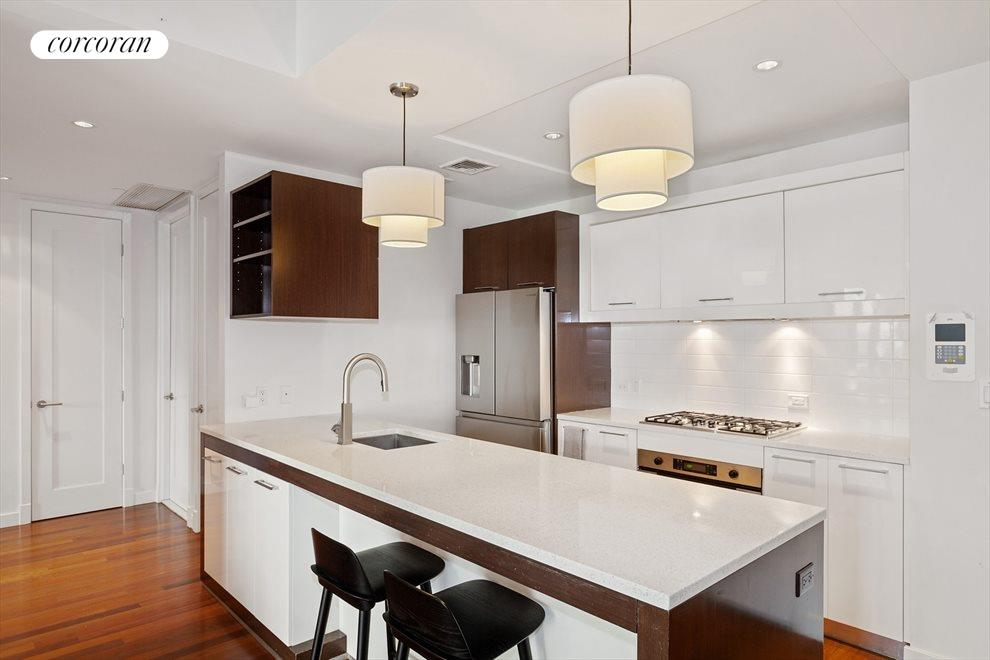 bright, modern, large open kitchen w/breakfast bar