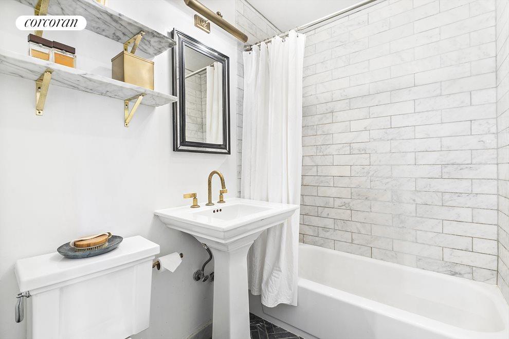 Marble Bathroom with Brass Fixtures