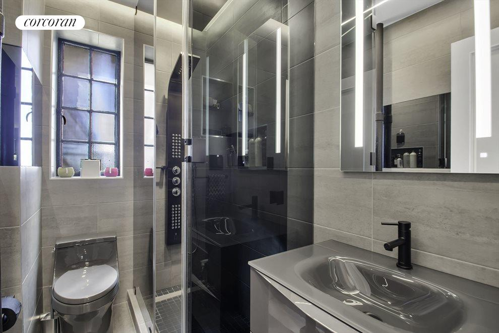 New York City Real Estate | View 116 PINEHURST AVE, #R41 | Fully renovated bathroom