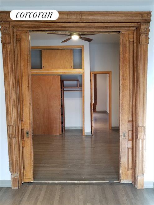 Restored pocket-doors leading to bonus room