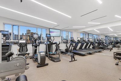 New York City Real Estate | View 30 East 62nd Street, #2H | Exceptional gym with views and rooftop terrace
