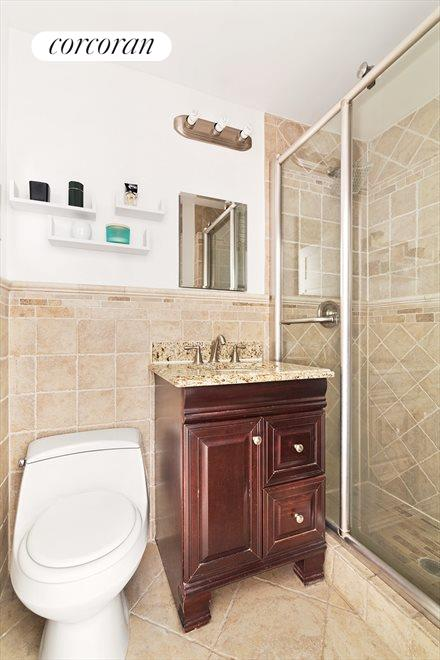 Updated bathroom with walk-in tiled shower
