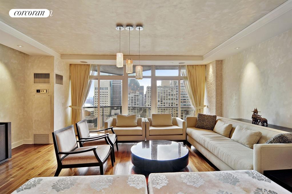 30th floor 3 bedroom, 4 bathroom apartment with two private balconies is now offered for rent at one of Midtown Easts premier white-glove condominiums, 100 United Nations Plaza.Pass through the formal entry gallery to enter the large, south-facing living and dining room. Drenched in natural light from its floor-to-ceiling windows and sliding glass door(s) to the first of two private balconies. An ideal setting for entertaining groups large or small and the perfect spot to take in gorgeous city and river views. Beautifully renovated, this room features hardwood floor, tray ceilings with recessed lighting, an in-wall media system and Venetian plaster walls. The adjacent windowed kitchen has been finished with granite counters and backsplash, wood cabinetry and stainless steel appliances including a Sub-Zero refrigerator and a full size dishwasher.The corner master suite has its own balcony and enjoys sweeping skyline views to the north along with an extra-large walk-in closet and renovated en suite bathroom with dual basin sinks, glass enclosed shower, heated towel rack and a stacked Bosch washer and dryer. The 2nd and 3rd bedrooms are equally sized, each with its own en suite marble bathroom, and would comfortable accommodate king sized beds or larger. This spacious home also features central heat and A/C with individual thermostat controls in every room, great closet space and a fourth full bathroom. 100 United Nations Plaza is a white-glove full service condominium located in Midtown Easts Turtle Bay neighborhood on East 48th Street and 1st Avenue. Residents are welcomed home with beautifully landscaped gardens and waterfalls. This impeccably run building offers a 24-hour doorman and concierge service, on-site management office, renovated lobby and residents lounge, fitness center, common laundry room, bike storage and direct access to a 24-hour attended parking garage. Conveniently located to a variety of neighborhood shops, restaurants and conveniences as well as