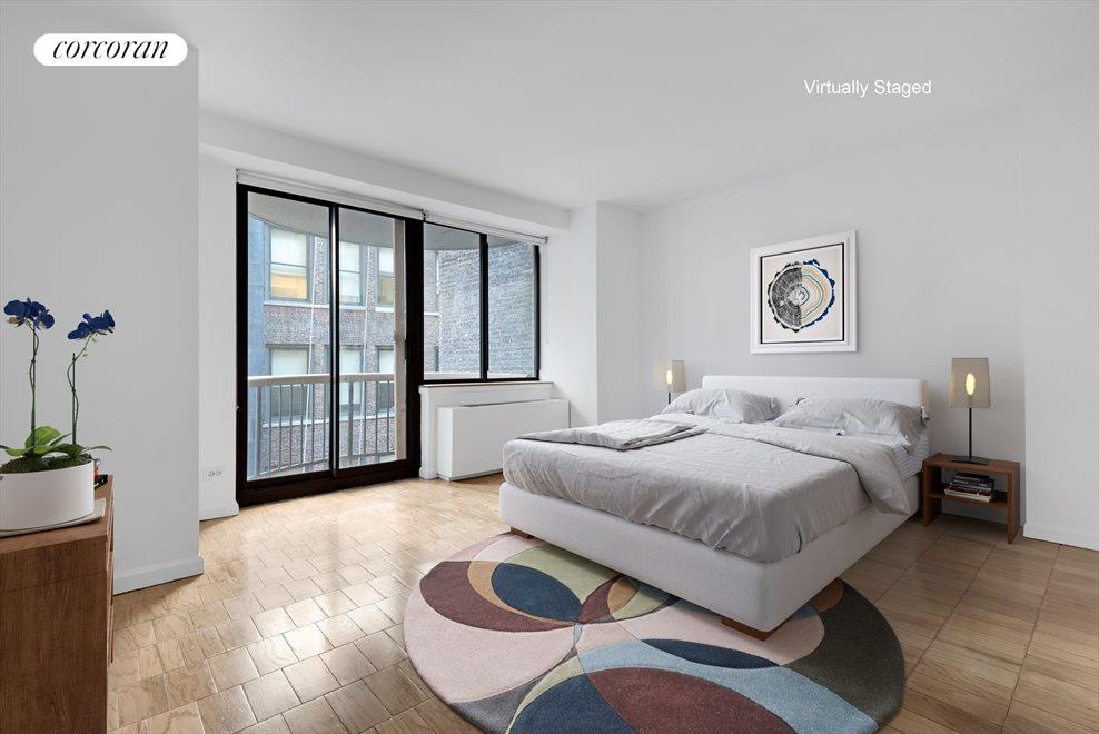 LARGE BEDROOM WITH GREAT CLOSETS AND A BALCONY!