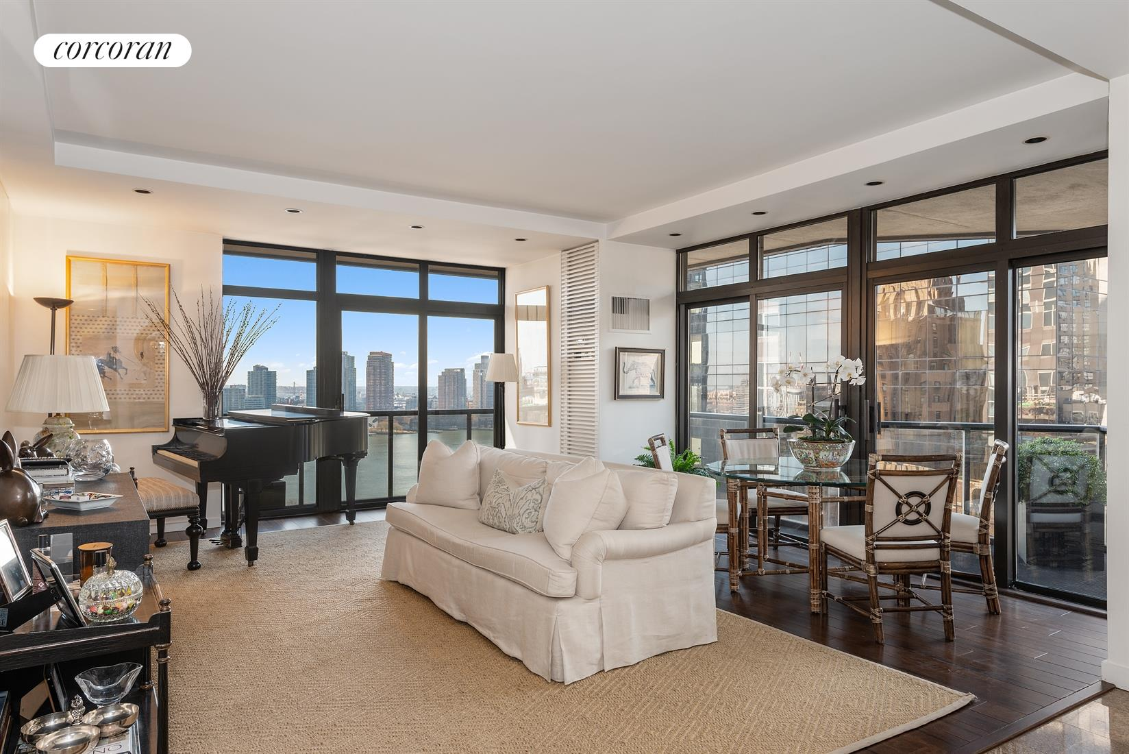 Enjoy spectacular East River and southern skyline views from this renovated, 23rd floor 2 bedroom, 2.5 bathroom with wrap balcony now offered for sale at 100 United Nations Plaza.Offering a split bedroom layout and 1,324 square feet of interior living space, apartment 23B boasts a renovated kitchen and powder room, hardwood and marble flooring, recessed lighting and a 154 square foot private wrap-around balcony. Pass through the inviting foyer into the sunlit corner living and dining room to take in the beautiful backdrop of city and river views from its floor-to-ceiling windows and private wrap balcony. Spacious enough for separate living and dining areas, there is also a built-in dry bar for easy entertaining. The adjacent windowed kitchen has been completely renovated and features crisp white cabinetry, Caesarstone countertops, modern tonal tile backsplash and full size stainless steel appliances including a Wolf range and Sub Zero refrigerator. The generous master suite is the perfect retreat for the end of a long day. Comfortably accommodating a king size bed along with additional furnishings, it offers two closets (one is a walk in closet) and an en suite marble bathroom with an extra-large vanity and soaking bathtub with sliding glass doors. Pin-drop quiet, the second bedroom has with an eastern exposure along with its own en suite marble bathroom. In addition, this fantastic unit has central heat and A/C and a renovated powder room with a pedestal sink and marble accent tile. Located on East 48th Street and First Avenue, 100 United Nations Plaza is a white-glove, full service condominium in Manhattan's Turtle Bay neighborhood. Greeting residents with beautifully landscaped gardens and waterfalls, this impeccably run building offers a 24-hour doorman, valet and concierge service, on-site management office, renovated lobby and resident's lounge, common laundry room, fitness center and direct access to a 24-hour attended parking garage. Conveniently located to 
