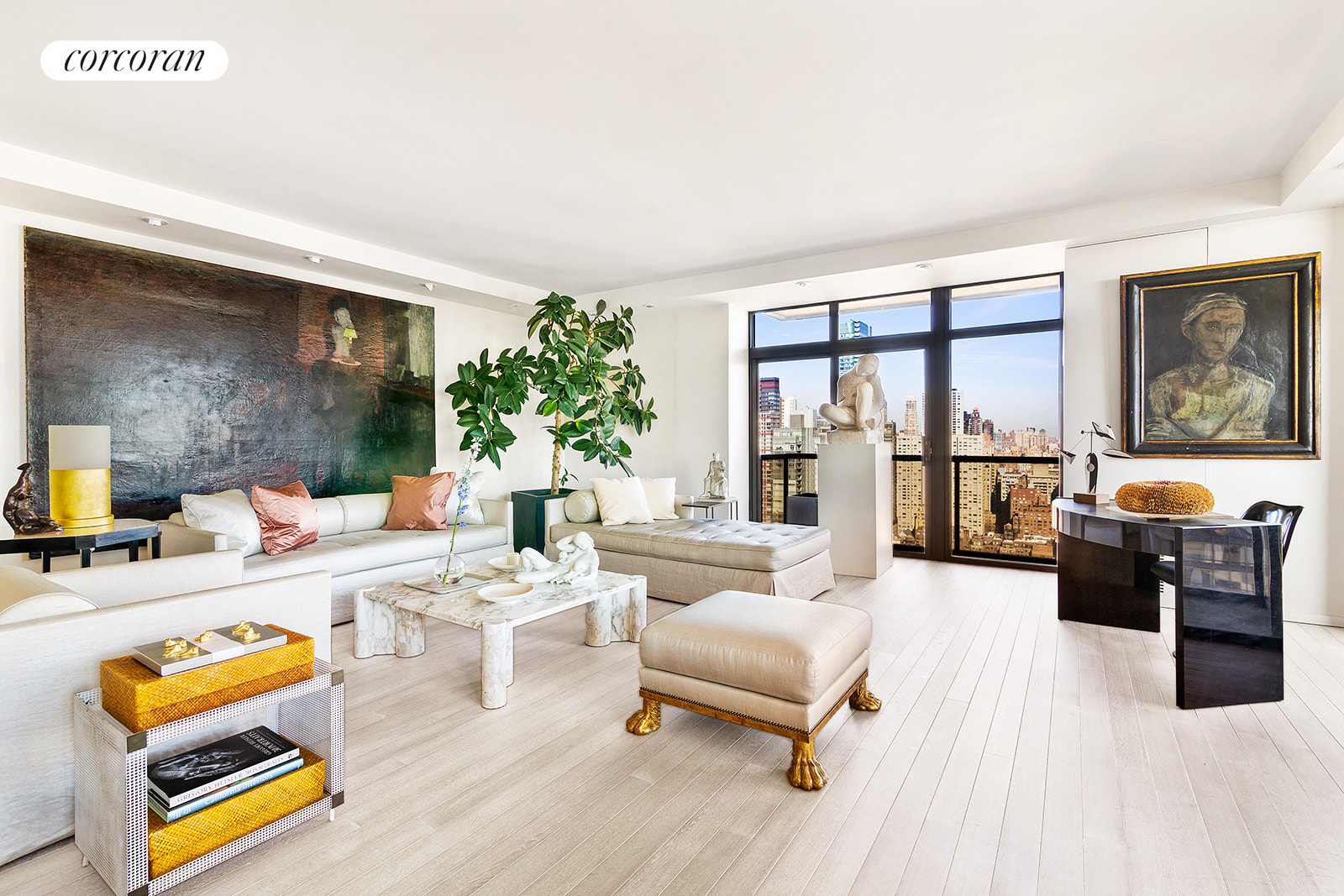 Designer renovated triple mint condition 2 bedroom, 2.5 bathroom corner unit with a private balcony and dramatic city and East River views available at 100 United Nations Plaza, one of Midtown Easts premier white-glove condominiums.   Well-proportioned and thoughtfully designed, conveying a quiet elegance, this mint condition apartment offers 1,539 square feet of interior living space plus 153 square feet of outdoor space and features a split-bedroom layout, windowed kitchen, renovated bathrooms, custom built-ins and recessed lighting throughout. Distinctive finishes include an exposed structural concrete wall, Siberian oak flooring and solid wood doors on pivot hinges for a clean aesthetic.  Passing through the entry foyer, down a short hallway and to the left is the welcoming corner living room, bathed in natural light from its floor-to-ceiling windows highlighting iconic skyline views to the north and river views to the east. This generous room allows for comfortable seating as well as separate dining and work areas. Sliding glass doors provide access to the balcony, a custom cabinet conceals media equipment and a wall of built-ins with black accents perfectly echoes the window frames across the room while providing additional storage space. The windowed kitchen boasts textured yet sleek custom cabinetry from leading Italian manufacturer, Valcucine, set in contrast with an exposed concrete wall, granite countertops and a suite of high-end appliances from Gaggenau, Sub-Zero and Miele. The serene master bedroom suite has a wall of north-facing windows, marble-topped custom built-in storage, and three sizeable closets. The renovated en suite bathroom is finished in a warm neutral palette of mosaic tile and marble and has a marble-topped vanity, glass enclosed shower and separate Jacuzzi bathtub. The large second bedroom is located just off the gallery and boasts views directly overlooking the East River from its wall-to-wall windows. Custom outfitted closets and an 