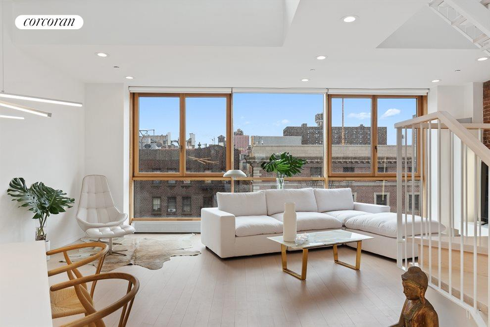 Living and dining boasts double height ceilings