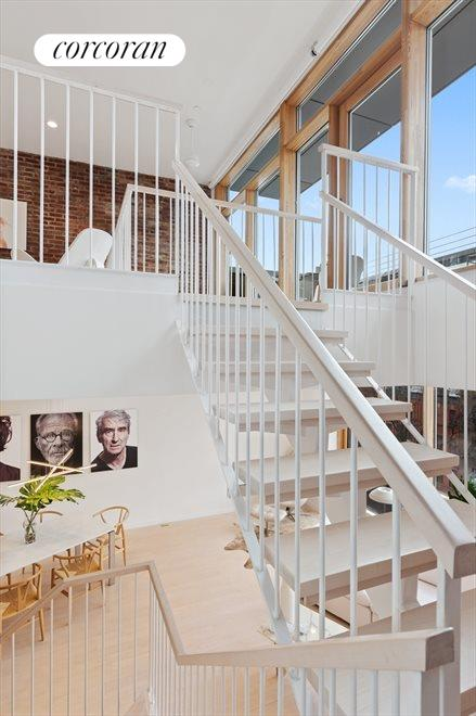Architectural staircase takes you to upper level