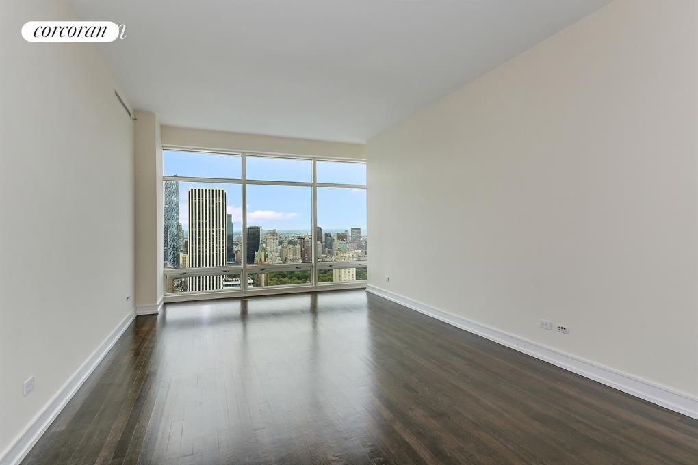 STUNNING TWO BEDROOM APARTMENT WITH SENSATIONAL VIEWS OF CENTRAL PARK This two bedroom, two and a half bath Condominium has unforgettable views of Central Park, the Hudson River and the City's skyline from floor to 11 ft ceiling windows; full Western exposure to the Park from the bedrooms and Living room . The foyer plus the formal entrance gallery along with the solid wood floors add to the refinement of this home. The kitchen has lacquered cabinetry, stone counters, granite floors and state-of -the-art appliances. The bathrooms have mosaic marble floors, white marble counters and wood cabinetry creating a luxurious retreat. The master bathroom features a soaking tub, separate stall shower and double sinks. The building's grand foyer entrance underlines this Prestigious Residential Address. One Beacon Court was created by the International Architect Cesar Pelli & Interior Designer Jacques Grange and is a modern classic, inspired by the shape of the Pantheon in Rome. Sculptured from glass and steel its light filled courtyard and glowing crown is where sophisticated Upper East Side meets dynamic Midtown. Beacon Court is a full service white glove building having a state-of the-art fitness room, lounge, High Speed Internet Access and Business Center. At the Owners request please No Pets Enjoy this wonderful and exciting location for its proximity to New York's finest restaurants and shopping. Long term Lease preferred. Sorry, evening or weekend showings are not permitted