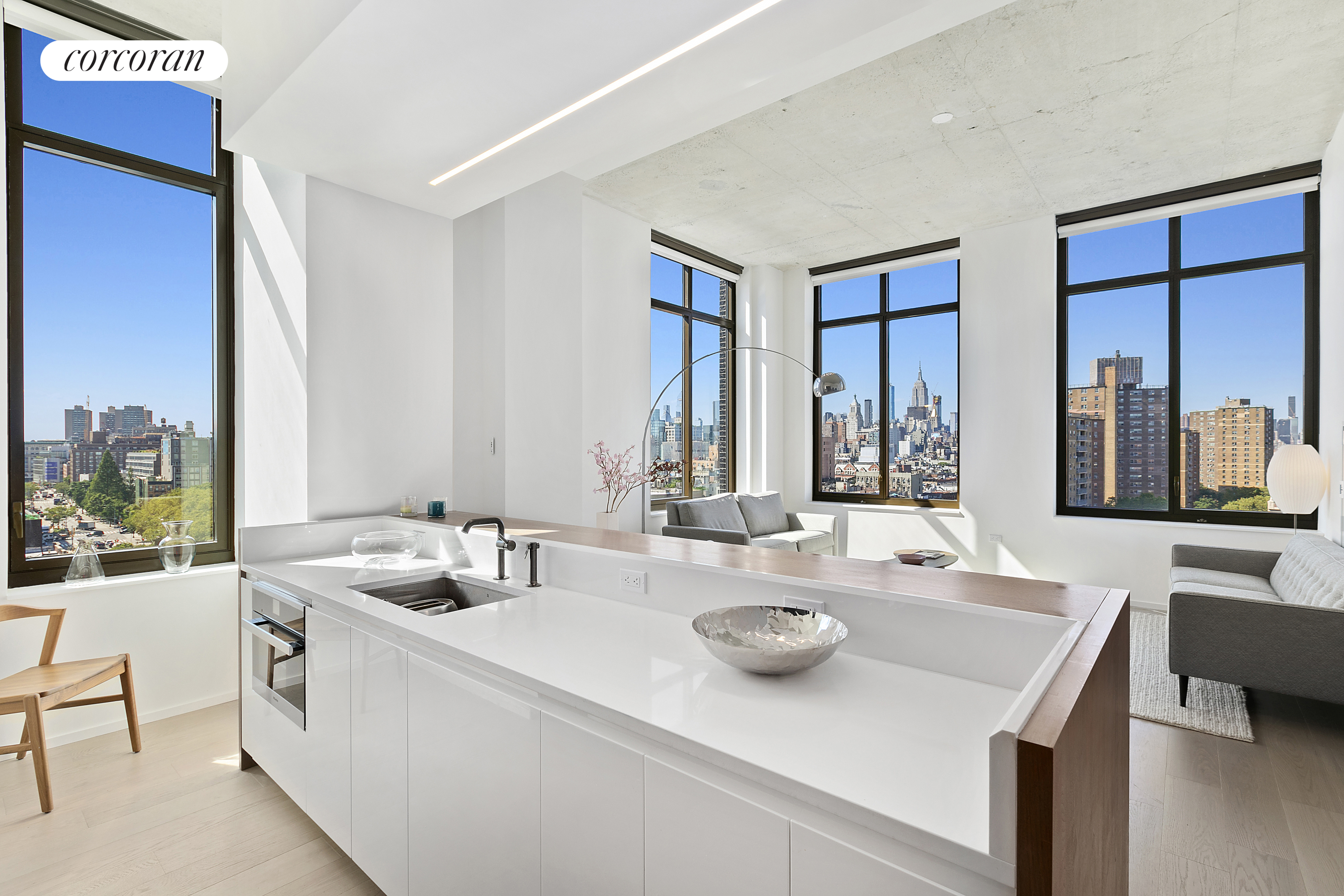 Stunning Skyline Views - BEST UNIT IN BUILDING - First Penthouse Resale at LES - premiere new development condominium - 196 Orchard Street!  This unique 1,409SF North\West corner designer penthouse with two split bedrooms, two and a half bathrooms expertly blends the best of Downtown style with polished modern luxury.  Designed by Incorporated Architecture & Design, Penthouse E features fabulous 12ft exposed concrete ceilings, gorgeous wide-plank white oak floors, and massive industrial style windows that showcase truly breathtaking views of the Manhattan skyline from every room. The stylish and functional custom open kitchen with built-in Miele appliances includes onyx lacquer cabinetry, polished marble backsplash, quartz countertop with cabinet lighting, and a kitchen island with wine refrigerator. The master bathroom boasts Blue de Savoie marble floors, marble shower and bathtub, Waterworks fixtures and white lacquer vanity with polished quartz countertop. This stylish penthouse home is completed by an LG stacked washer and dryer and a gorgeous powder room with Eramosa marble floor.   196 Orchard street is a chic and stylish full-service condominium perfectly located where the East Village and Lower East Side meet. The building has a 24 hour attended lobby, truly magnificent 4,300SF residents' rooftop lounge with outdoor kitchens and spectacular city views, and a bicycle room. Residents also receive a discount at the state-of-the-art two-story, 30,000-square-foot Equinox Fitness Center and Spa with a private entrance that occupies the second and third floors.   The monthly real estate taxes listed are the actual taxes paid by the current owner. Please consult your real estate attorney for information about tax rates for different forms of ownership and uses (primary vs. secondary/investment).