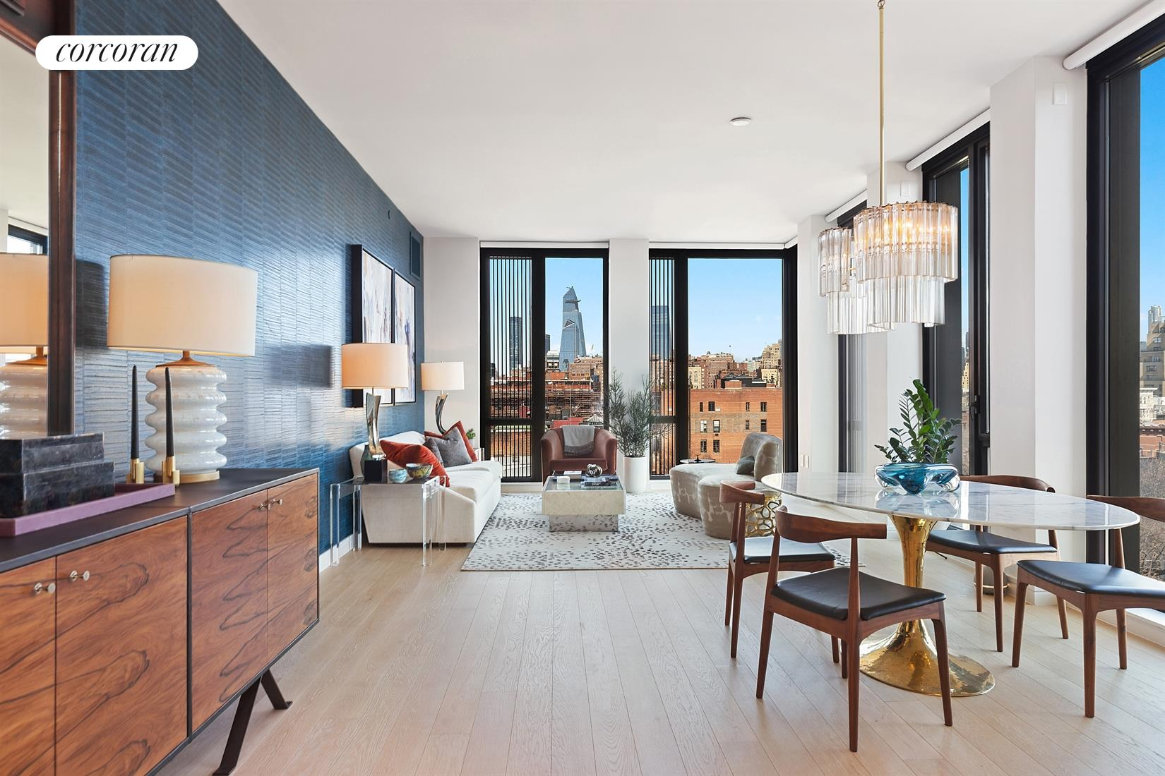 NEW TO THE MARKET! -- RARELY AVAILABLE ARCHITECTURAL MASTERWORK: TRIPLE MINT, TRIPLE CORNER, 3-BR/3.5-BATH IN THE HEART OF THE WEST VILLAGE -- WITH PANORAMIC VIEWS!Welcome to Apartment 9B at 100 Barrow Street. The moment you enter through the gracious foyer of this sprawling, over 2300 square foot, triple-corner apartment, you are immediately struck by the spectacular views of New York City. This stunning, light-flooded home features floor-to-ceiling windows  dazzling exposures north to the Empire State Building and beyond, and east for beautiful sunrises. 9B boasts 3 full bedrooms, 3.5 bathrooms with a modern aesthetic, wonderful high ceilings, wide-plank oak floors and so much more  all of which complement the exacting attention to craft and fine-grained detail throughout.Dine in the magnificent Chefs kitchen that overlooks the historic Barrow Gardens and showcases spectacular city views both north and east -- perfect for morning coffee and watching the sunrise. Grey oak Poliform cabinets, custom hardware and fixtures in oil-rubbed satin bronze crafted by Watermark Designs, harmonize with Carrara marble countertops and backsplash, Gaggenau appliances, a wine fridge and even a garbage disposal. The setting is warm and cozy for relaxed entertaining.The gracious corner master bedroom suite with a separate foyer for additional privacy, offers its own amazing views uptown and a gorgeous, windowed en-suite bath. An oasis of cool grey and black, the master bath offers ample opportunity to luxuriate, from a relaxing, marble soaking tub to a soothing, glass-enclosed shower room. The bathroom's subtle palette includes beautifully veined grey marble walls, floors and tub surrounds of rich black marble, Carrara marble counters, and exactingly detailed oil-rubbed satin bronze door frames and plumbing fixtures. The bedroom has a custom built-out, walk-in closet. Indeed, when it comes to closet space, this home is every New Yorkers dream.Residence 9B has a luxurious, generously-proportioned second bedroom, plus a third bedroom with city views that can also serve as a home office or den. There is a lovely, well-positioned powder room and a laundry room with a large Whirlpool washer/dryer set, automated window treatments, Crestron control panel system and a multi-zone heating and cooling system with climate control. All bathrooms have radiant heated floors. But the true centerpiece of this extraordinary home is an impressive 28-foot grand hallway with ample space to house anyone's art collection as it seamlessly divides the public rooms from the sleeping quarters.100 Barrow is a full-service, boutique condop and a graceful new addition to its West Village surroundings. Situated on a prestigious, cobblestoned block and built near St. Lukes Church in the Fields (one of the city's historic churches), the residences occupy a magical, idyllic spot within Manhattans oldest landmark district. The spacious, carefully-crafted interiors, designed by Bernheimer Architecture, extend throughout the building. A dedicated floor brings together the exclusive amenities that enrich the experience of living at 100 Barrow. The heart of the elegantly-appointed amenity level is a wine cellar and tasting room, a dramatic vaulted space lined in white oak and wrapped in walls of bold black granite. Inside are dedicated cellar racks for your personal wine collection and a black marble table to host private tastings. Adjacent is a gracious dining area, a catering kitchen, and a residents' lounge that offer an inviting setting for private gatherings. Services and amenities also include a twenty-four-hour concierge, fitness studio, steam room and sauna, kids playroom, bike storage and pet spa. 9B also transfers with an extra-large storage unit.There is no board interview, which makes for a quicker purchase. Additionally, there is a 421-A tax abatement in place. Conveniently located to transportation, the West Side Highway, wonderful neighborhood restaurants and the Brooklyn Fare supermarket. The building is pet friendly.  This is a property of distinction that must be seen to be fully appreciated.
