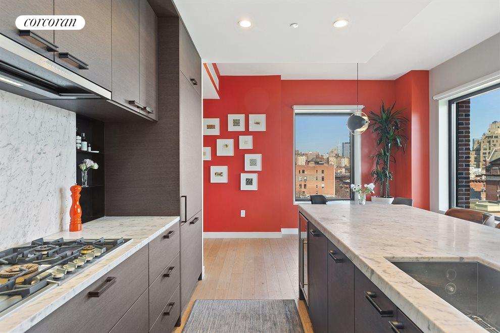 New York City Real Estate | View 100 Barrow Street, #9B | Open Chef's Kitchen | Carrera Marble Throughout