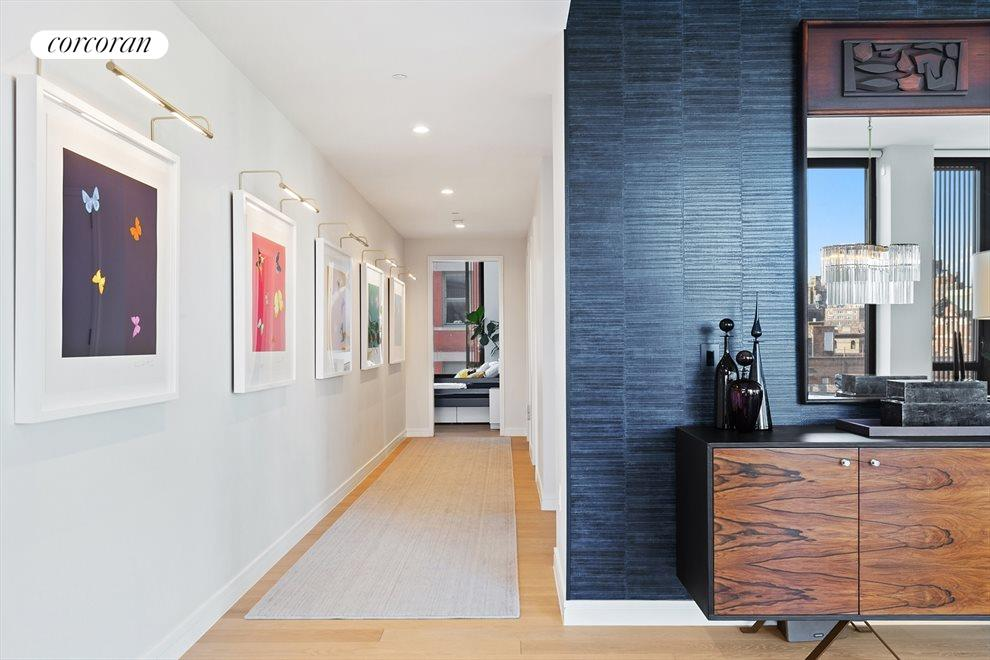 New York City Real Estate | View 100 Barrow Street, #9B | 28-foot Grand Hallway | Gallery Wall