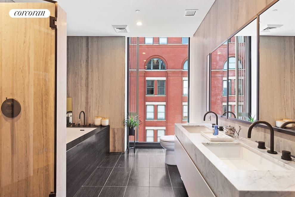New York City Real Estate | View 100 Barrow Street, #9B | Windowed Master Bath | Soaking Tub | Glass Shower