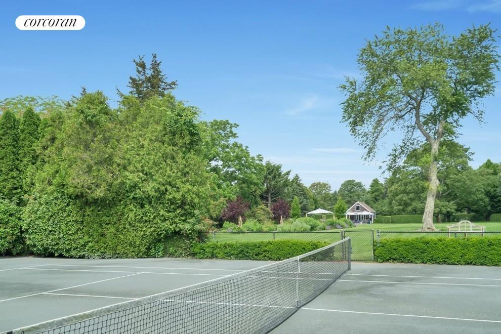 Sunken tennis hidden in 3 acres
