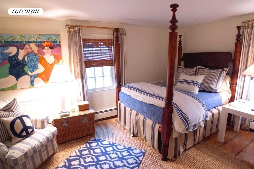 One of 4 guest bedrooms