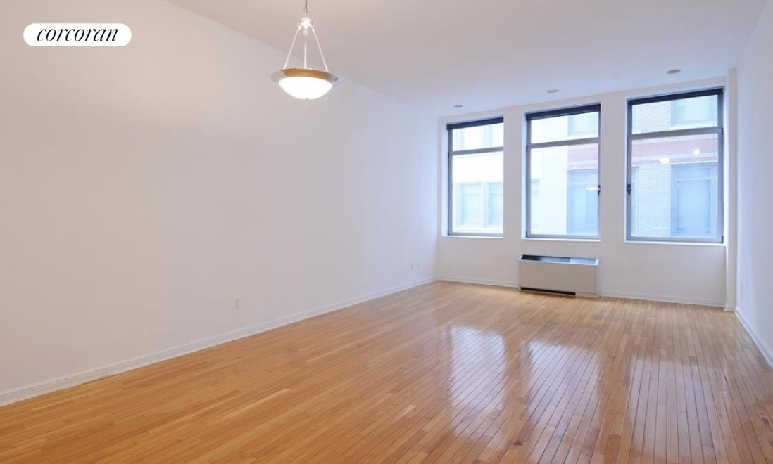 Be the first one to live in this newly renovated huge, loft-like one bedroom with high ceilings and large picture windows at The Chelsea Mercantile 252 Seventh Ave 8S. Available for April 1, we are just putting the final touches on this gorgeous home- almost 1000 square feet- with new hard-wood blond oak flooring, fresh paint, and brand new kitchen and bath. The kitchen will showcase brand new custom oak cabinets and all stainless appliances from Fisher & Paykal with light grey granite counter tops. The bathroom has a similar light grey color scheme with custom tiling creating a spa-like experience with Bosch washer/dryer in the closet close by. Built in 1908, The Chelsea Mercantile is a luxurious pre-war building offering its residents the utmost of care and attention with full-time doorman, concierge, valet service, gym, playroom, and roof deck. Located in prime Chelsea, you are just seconds away from all your modern conveniences including a parking garage with access from the lobby. PHOTOS are pre-renovation and renovations are being completed now, available April 1 at 252 Seventh Ave #8S.