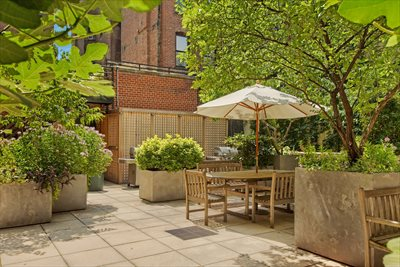 New York City Real Estate | View 350 Bleecker Street, #4U | Rear Courtyard Barbeque Areas