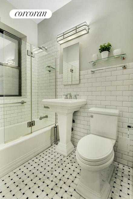 RENOVATED BATH WITH EXQUISITE TILE WORK