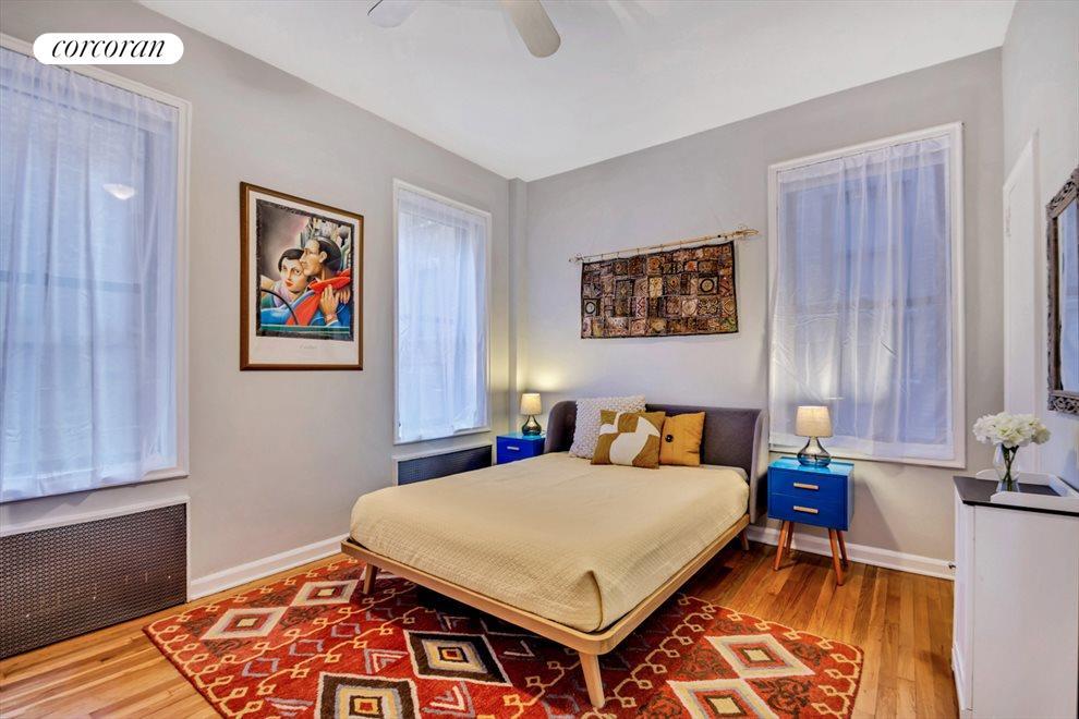 LARGE MASTER BEDROOM WITH THREE WINDOWS