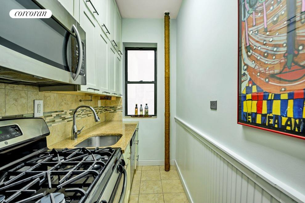 RENOVATED KITCHEN WITH WINDOW AND CABINETS GALORE