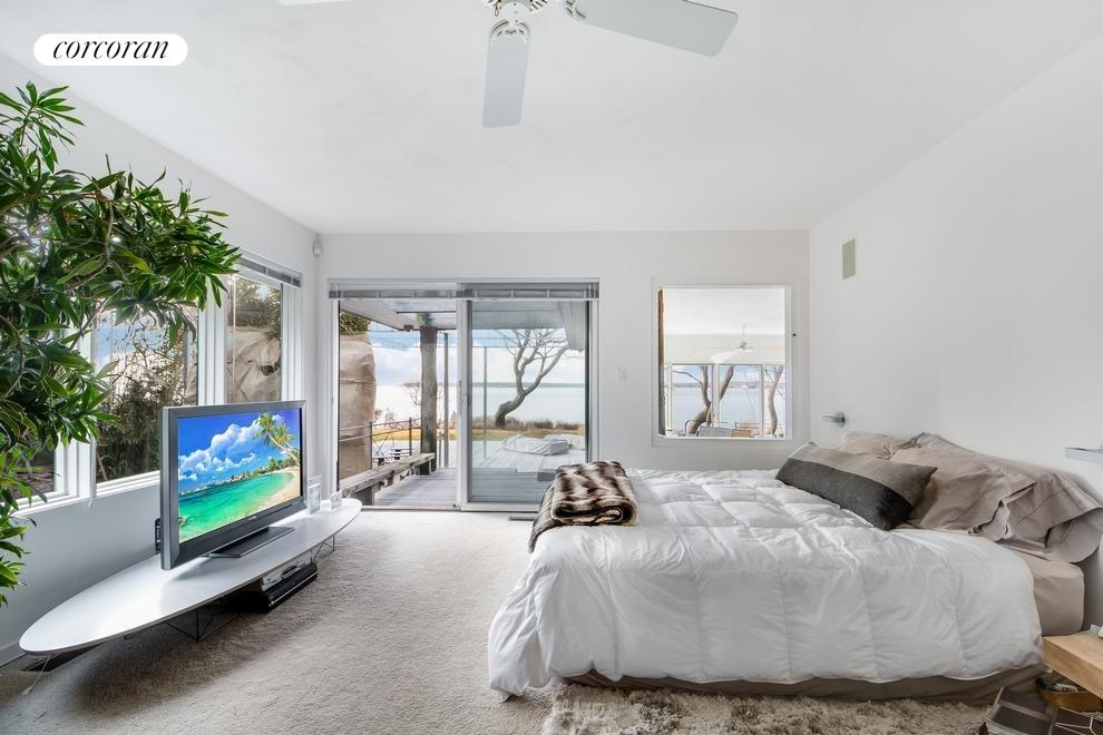 Master bedroom has panoramic views and opens out to the deck