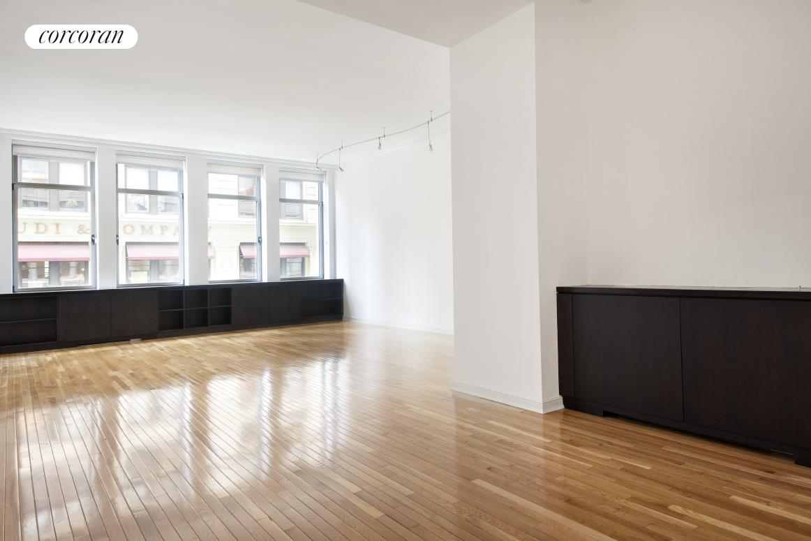 A loft-like condo in Chelsea's most desirable building, this 1,531 square-foot two-bedroom, two-bathroom apartment features hardwood floors, 11-foot ceilings, and oversize windows that flood the apartment with natural light.The open, spacious living room leads into a large dining area, providing ample room for entertaining, while the enclosed kitchen offers stainless steel appliances, cherry wood cabinets, granite counter tops, and lots of storage space. The light-filled master bedroom has an oversized closet and very large French limestone en-suite bathroom complete with a soaking tub, separate stall shower and double-sink vanity. The second bedroom can be used as a den or regular bedroom. There is a washer/dryer in the unit as well as completely outfitted closets, and the apartment comes with on-site storage in the building.A stately prewar property outfitted with an array of modern amenities, The Chelsea Mercantile is one of New York's hottest condominium buildings, attracting an elite roster of residents. Its ideal location in the heart of Manhattan with access to several subway lines as well as Madison Square Park and the Chelsea galleries. On-site amenities include a 10,000-square-foot landscaped panoramic roof deck, fitness center and playroom. There is a 24-hour doorman, concierge and valet, as well a public garage and Whole Foods grocery on the lower level of the building.