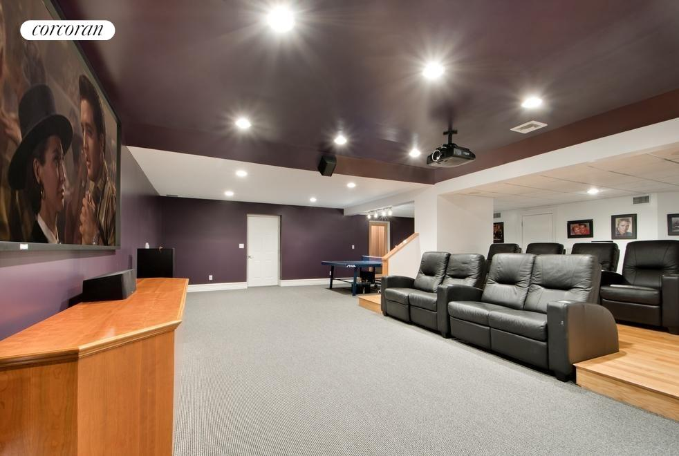 Lower level theater, game area and sauna