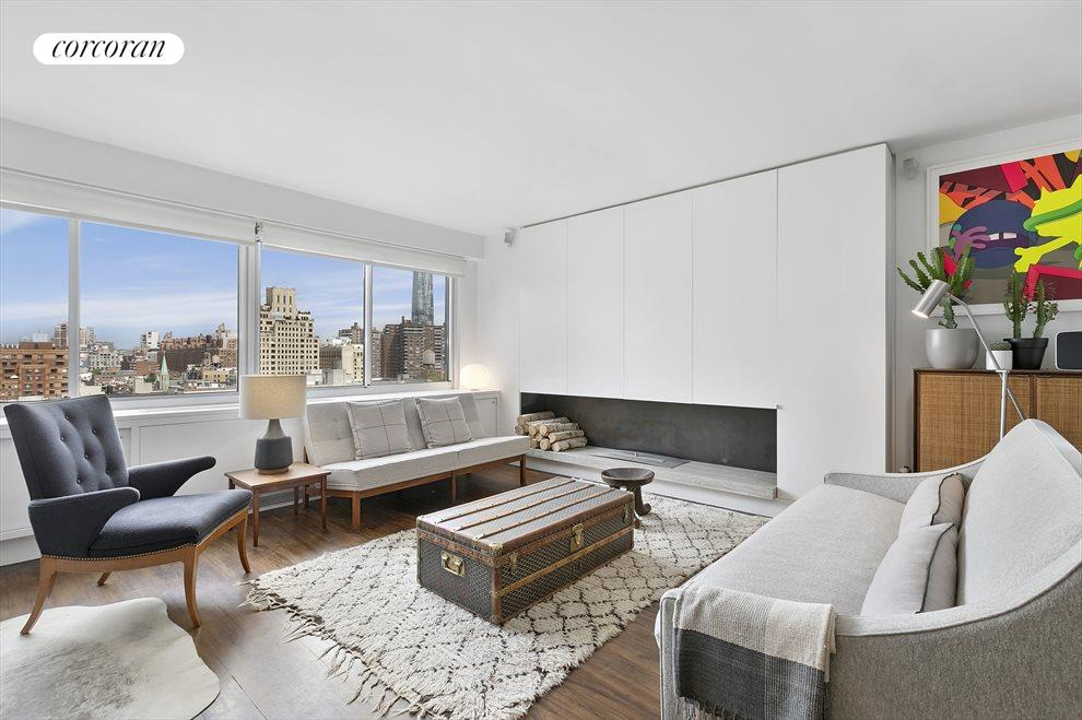 New York City Real Estate | View 201 West 21st Street, #PH14/15 | Living Room with Fireplace and Skyline Views