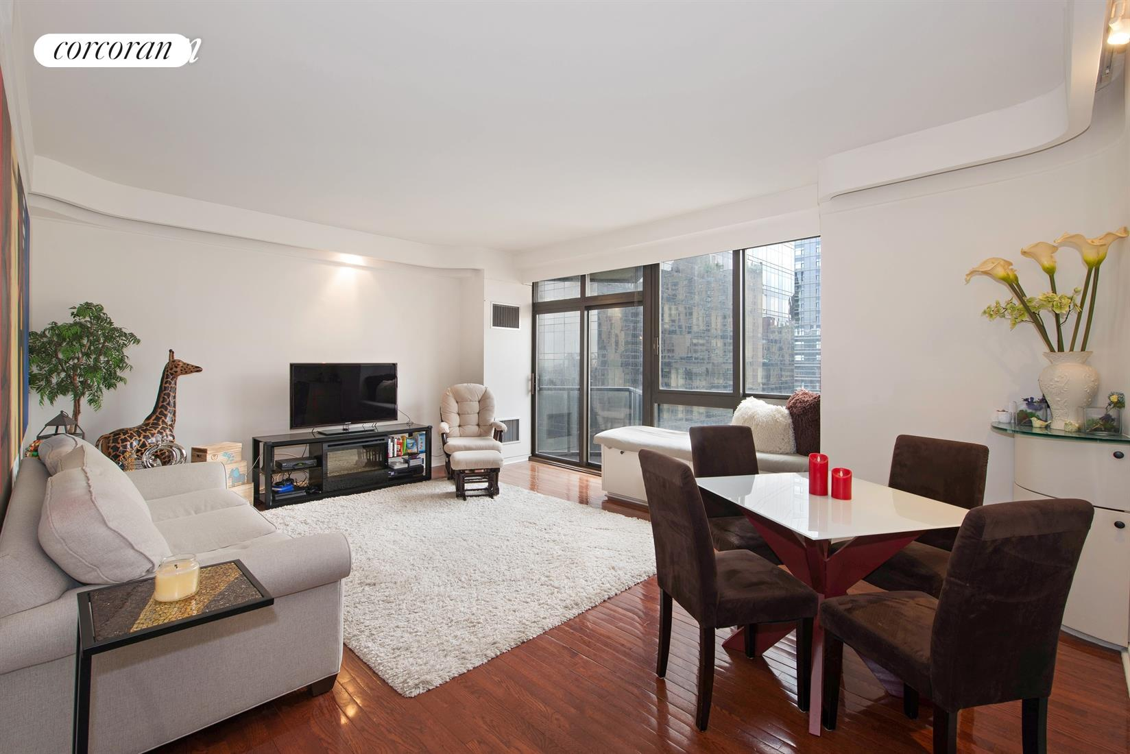 Fantastic, sun-flooded 1 bedroom, 1 bathroom apartment available for rent at 100 United Nations Plaza  one of Manhattans premier white-glove condominiums. Offering the largest south-facing one bedroom layout in the building, unit 22C enjoys amazing natural light from its oversized windows, 9-foot high ceilings and two private balconies. Step out onto either balcony to take in the direct East River views including the iconic Pepsi-Cola sign.The spacious living room is ideal for entertaining where you and your guests can enjoy impressive skyline views including the majestic Chrysler Building. It also features custom built-ins and cove lighting. The kitchen has a combination washer and dryer unit, while the sizeable bedroom has a wall of custom closets and its own private balcony.  The marble bathroom has a Jacuzzi bathtub and sliding glass doors. Additional features include hardwood floors and central heat and A/C. Minimum 1 year lease term. Sorry no pets allowed.Located on East 48th Street and First Ave - 100 United Nations Plaza has an amazing staff, 24 hour doorman, valet and concierge service, a beautifully renovated lobby, on-site management office, a newly renovated meeting room/party room, beautifully landscaped gardens with waterfalls, laundry room, a residents only fitness center and an attached 24 hour attended garage. Conveniently located to transportation and many great restaurants and shops.