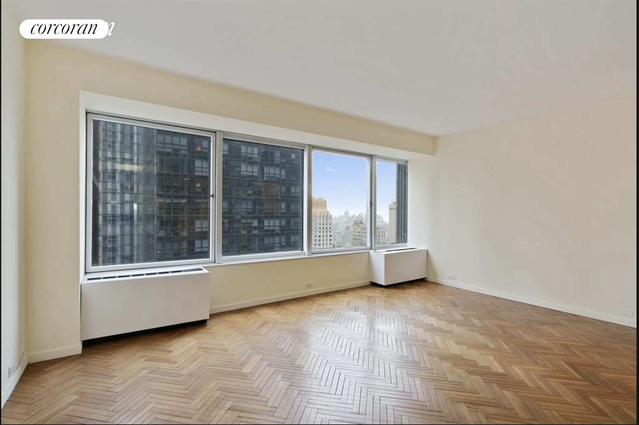 GREAT DEAL on this desirable alcove studio in the sky, with open views! This 36th floor, sunny, oversized studio with a wall of windows taking in sweeping bright open north facing views, sits high above midtown Manhattan in one of the neighborhood's most well-known condominiums, City Spire. There are hardwood herringbone floors throughout, a pass through kitchen with stainless appliances, three good sized closets and room for a separate sleeping area, and spacious living/dining. Enjoy the convenience of a washer/dryer on the floor!  No pets allowed. CYOF, ALSO!City Spire is a full service condominium with 24-hour doorman and concierge, a state-of-the-art health club with 50' pool, sauna and steam room, playroom, business center, and parking garage. There is even laundry on every floor. Conveniently located near transportation, shopping, restaurants, Columbus Circle, and Central Park.Video Tour: https://youtu.be/sLkufzedujA