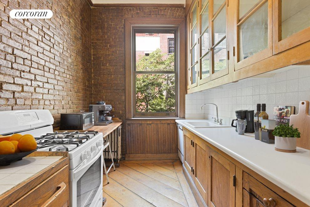 New York City Real Estate | View 263 West 90th Street | Charming kitchen in the garden duplex
