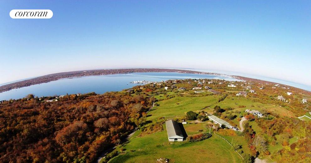The Hamptons Real Estate | View 107 and 101 Startop Drive South | lake, harbor, sunset vistas