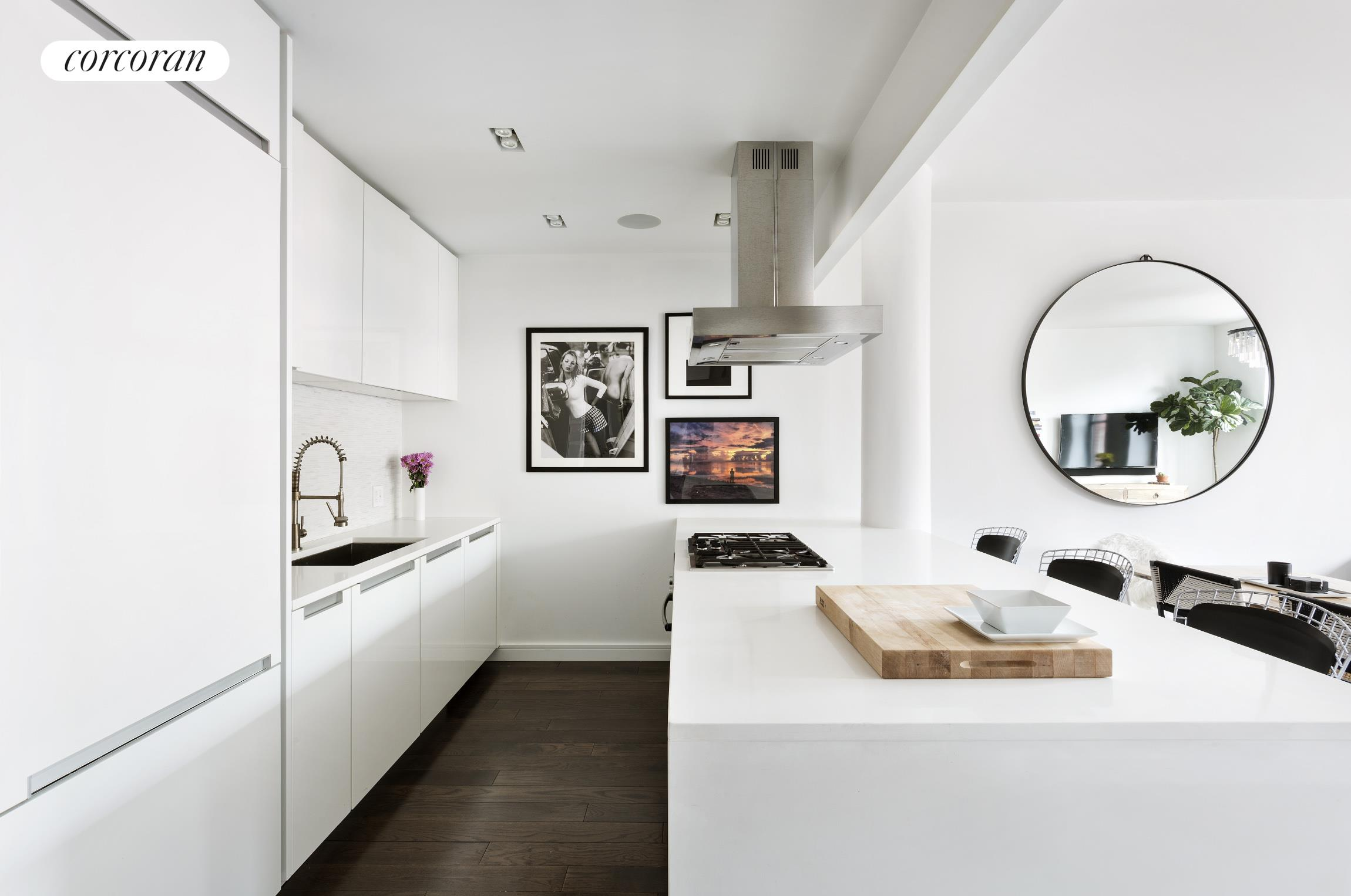 Apartment 6K at the coveted building, 250 West Street, is 1035 square feet of oversized loft living in the heart of Tribeca.Thoughtfully laid out, 6K features a generously proportioned living, dining, and entertaining space. The open chef's kitchen includes a large center island with Poggenpohl cabinetry, Sub-Zero fridge & freezer, Bosch range, dishwasher, and wine fridge. Marble-clad primary bath features a double sink and deep soaking tub. Iconic oversized arched windows, 10-foot ceilings, and 5-inch wide American oak plank floors add to this impressive space.Meticulously renovated as a Crestron smart home, 6K includes automated lights, recessed electric shades and music sound system throughout. Additional features to note; custom Nathan Orsman lighting, fully fitted dressing area, and in-unit Miele washer/dryer. *AC & electricity included in rent*250 West Street is a full-service luxury building located in Tribeca's historic landmark district. Amenities include 24-hour doorman, wood-paneled library lounge, 61-foot pool, state of the art fitness center, playroom, and a 5,000 square foot roof terrace with panoramic views, sundeck, lounge, and dining area.