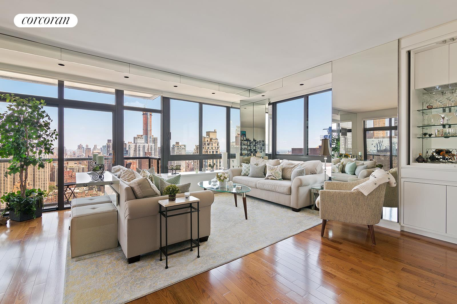 Elegantly designed and expertly renovated, mint condition amazing apartment with picturesque skyline views available for sale at 100 United Nations Plaza, one of Midtown East's premier white-glove condominiums.  This line is one of the largest and most sought after 1 bedroom layouts in the city.  A definite WOW apartment!Upon entering this perfectly appointed 1 bedroom, 2 bathroom unit high on the 37th floor you will be immediately drawn to the impressive open city, river and bridge views framed by three walls of floor-to-ceiling windows. Generous in space with a modern yet classic sensibility, the large open living and dining room boasts North, West and East exposures, a private wrap-around balcony, custom built-ins, a dry bar and recessed custom lighting. An ideal setting whether spending a quiet evening in or entertaining family and friends.The galley kitchen has been beautifully renovated throughout and features modern, crisp white cabinetry with contrasting countertops, large format stone flooring, a suite of stainless steel appliances by Samsung and custom built-ins for maximum storage.Down the hallway is a super spacious and peaceful bedroom suite. This king-sized bedroom is bathed in natural light from oversized windows with panoramic city views to the north, while five substantial closets plus a generous walk-in closet provide maximum storage space. The windowed en suite marble bathroom has a glass-enclosed shower, separate Jacuzzi bathtub and updated vanity.This immaculate apartment also features high ceilings, hardwood flooring, a second full, windowed guest bathroom, central heat and A/C, and a custom entry foyer with an interior glass-paneled door.Located on East 48th Street and First Avenue, 100 United Nations Plaza is a white-glove, full service condominium in Manhattan's Turtle Bay neighborhood. Greeting residents with beautifully landscaped gardens and waterfalls, this impeccably run building offers a 24-hour doorman, valet and concierge service, on