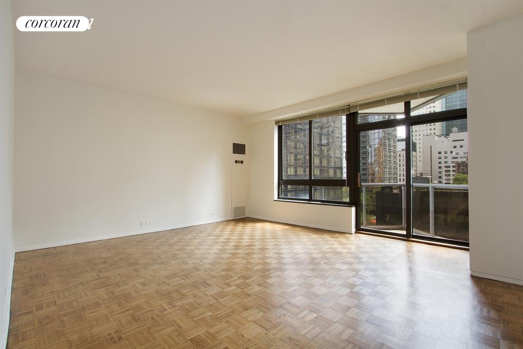 Great Sun Filled South Facing 1 bedroom apartment available at 100 United Nations Plaza - one of Manhattan's premier white glove condominiums.This south-facing apartment has great light, a private balcony off the living room, full-size appliances in the kitchen including a dishwasher, oversized windows, 9-foot ceilings, spacious rooms, and a great layout. Marble bathroom. City views.Located on East 48th Street and First Avenue, 100 United Nations Plaza is a white-glove, full service condominium located in Manhattan's Turtle Bay neighborhood. Greeting residents with beautifully landscaped gardens and waterfalls, this impeccably run building offers a 24-hour doorman, valet and concierge service, on-site management office, renovated lobby and resident's lounge, common laundry room, fitness center and direct access to a 24-hour attended parking garage.Conveniently located to transportation and many great shops and restaurants.Showing by appointment only.  Condominium application required.