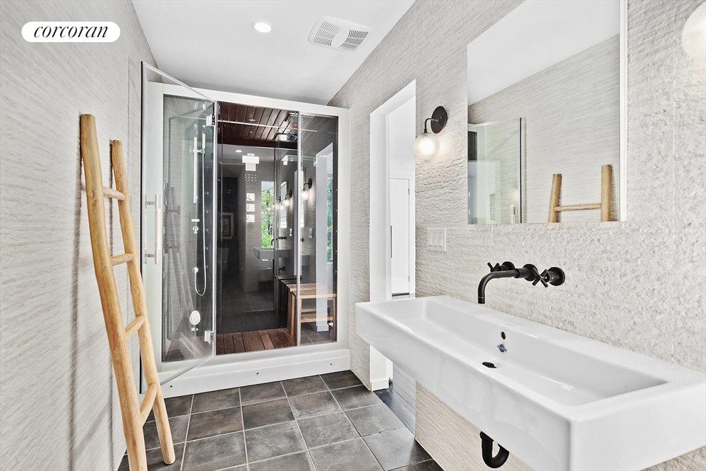 The Hamptons Real Estate | View 4 Honeysuckle Lane | First Floor Master Bath with Steam Shower, Rain Head and Multi-Spray Jets.  Built-in Stereo too!